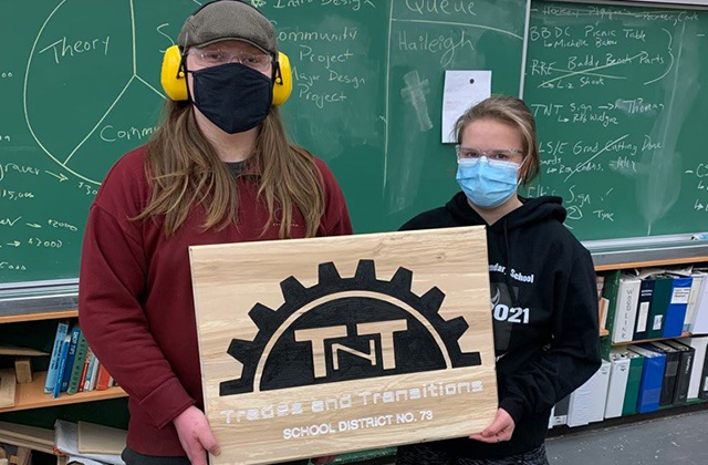 Thomas Lamash and Haileigh Goodie with the completed sign