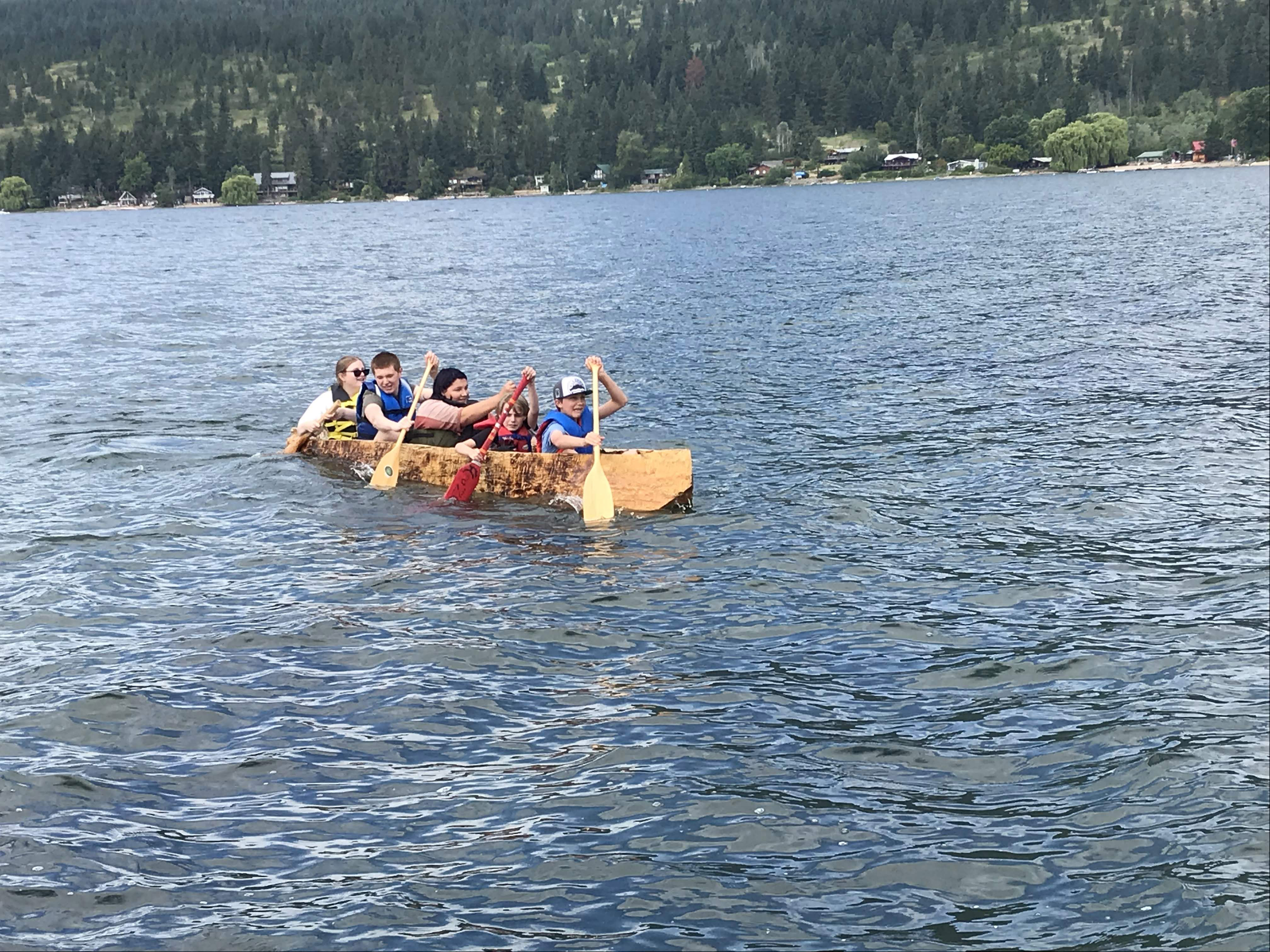 Brock Middle School students in their dugout canoe