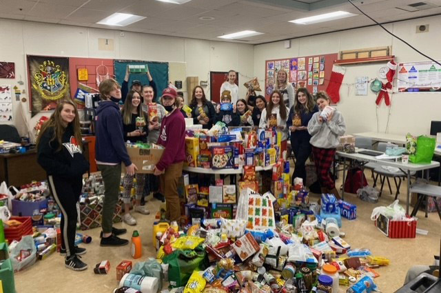 VVS students on the last day of class before winter break with some of the food gathered in their food drive
