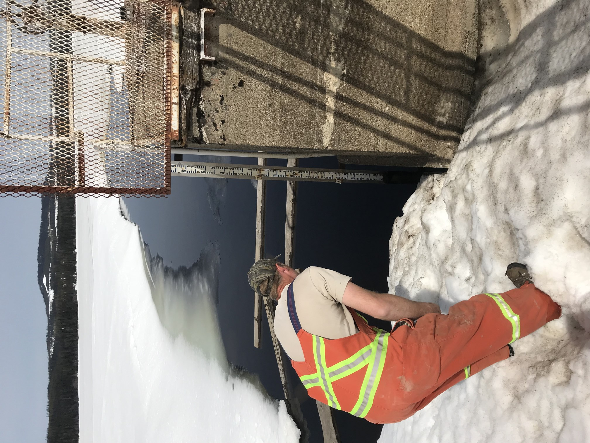Water Utility technician inspects water level at Beaver Lake control 2018-04-24
