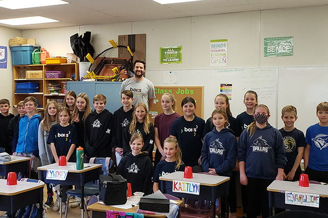Teacher Clay Cartie with students
